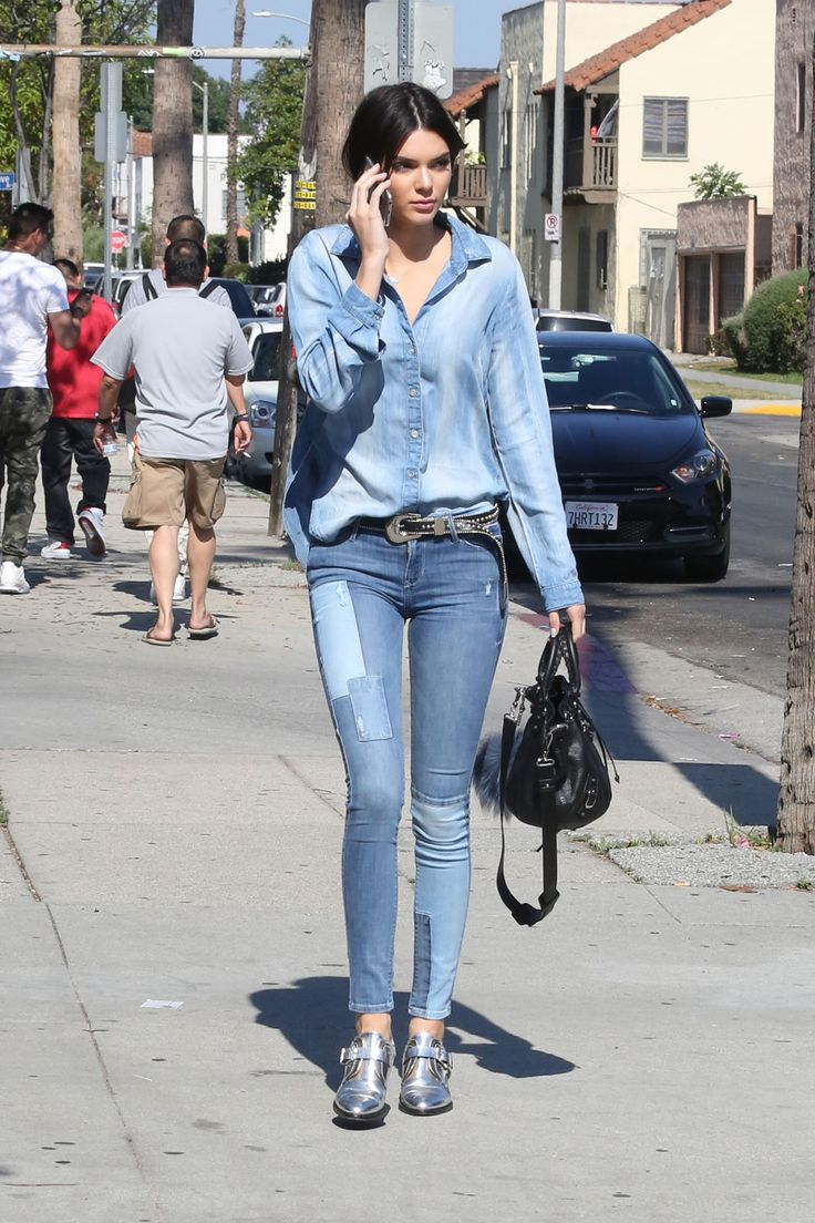 Jenner accessorizes her chic Canadian tuxedo with a pair of metallic loafers while out in Los Angeles.   - HarpersBAZAAR.com