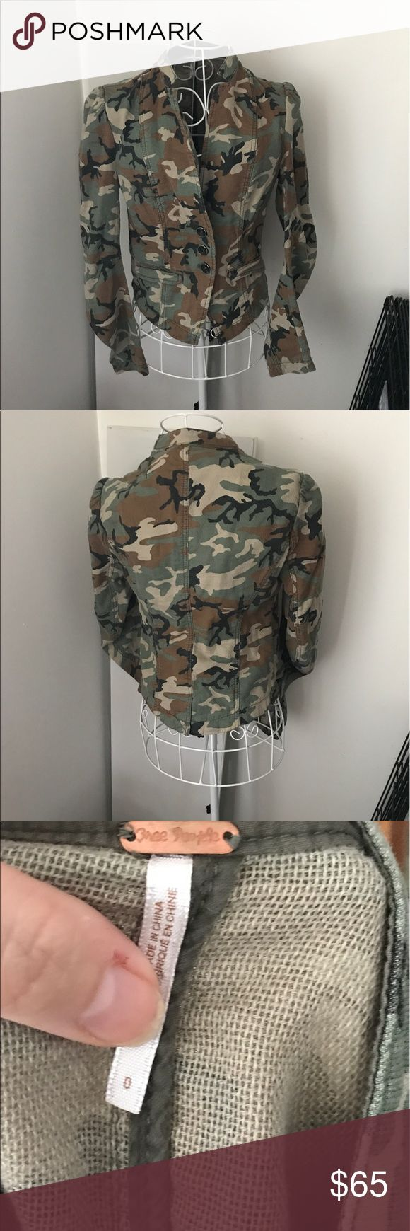 Free People camouflage jacket Faux pockets. condition as shown and reflected in price. This item is in good condition but it has been worn please ask any questions before purchasing. This item will only be traded for an autographed Authentic Chanel original, a Lamborghini, a penthouse in Paris, or the services of an Audi mechanic. All orders will be recorded before shipping. I do not model. Please see my reasonable offer chart before submitting an offer. Free People Jackets & Coats