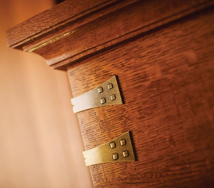 Cabinet bracket embellishments are used on the corners of for Craftsman style brackets
