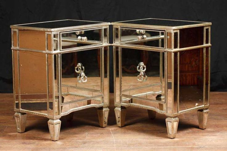 - Come view these in our Hertfordshire warehouse, just 25 minutes north of London<br /> - Stunning pair of art deco style mirrored bedside cabinets<br /> - Main cupboard opens out to reveal ample storage<br /> - Glass is clear and blemish free offset by silver gilt strip<br /> - Funky design<br /> - Offered in great shape and we will ship to anywhere in the world<br /> <br /> Dimensions are in cm:<br /> Height x Width x Depth<br /> 73 x 55 x 43<br /> <br /> Dimensions are in inches:<br…