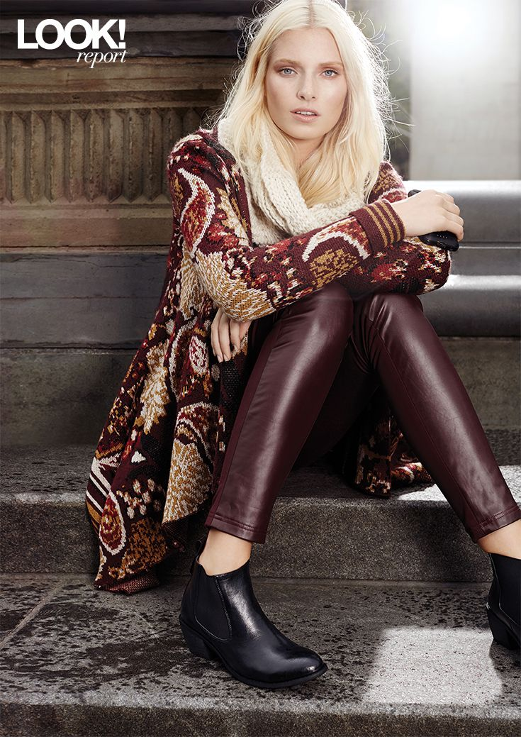 A stylish and trendy fall outfit. Faux leather boots and pants with a comfortable printed sweater