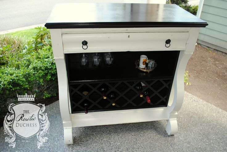 Empire dresser turned into a wine bar.  The body is done in #GeneralFinishes Antique White and sealed with High Performance Top Coat in flat.  All the wood work is finished with #JavaGel and sealed with HPTC in satin.  The lion'shead pulls were done in oil rubbed bronze.  #ShabbyChic #Painting #Wine #MilkPaint