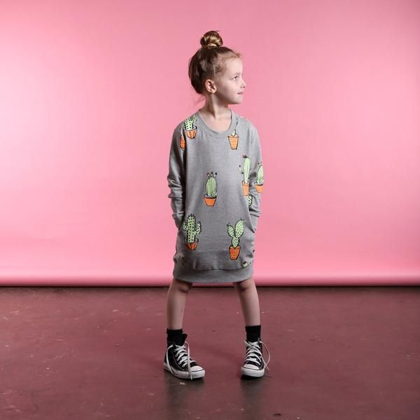 Minti Cactus Pocket Crew Dress in Grey Marle Minti are aboutique kids clothing brand based in Melbourne, Australia. They always design things that we think we'd like to wear(if we were small of course). We have a fantastic range of Minti available right here at Little Styles.
