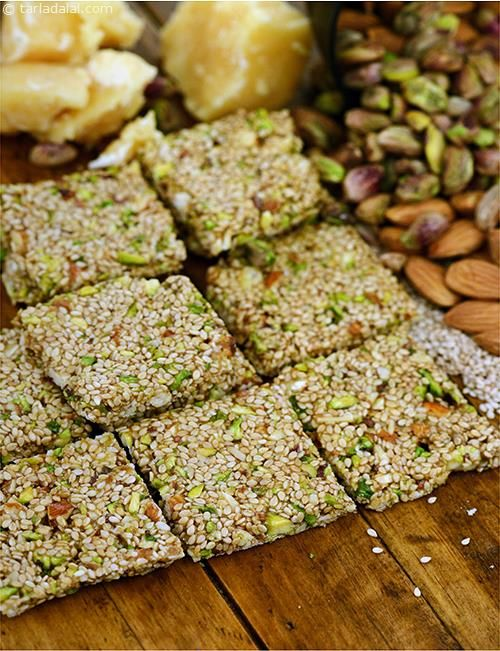 Jaggery replaces sugar in this wonderful Til and Dry Fruit Chikki, til imparts a very satiating mouth-feel and desi aroma to this interesting chikki, making it a wholesome treat for people of all age groups.