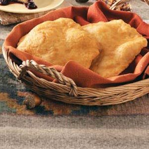 """Fry Bread: 1 c. all-purpose flour, 1 t. baking powder, 1/8 t. salt, 1/3 c. hot water, oil for frying.  Mix first 3 ingredients together, add hot water to form a soft dough.  Cover and let sit 30 min. Divide in half and roll out on lightly floured surface to form a 6"""" circle. Heat oil to 375 and fry on each side 2-3 min.  Drain on paper towels.  Yield:2"""