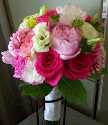gorgeous wedding bouquet with contrasting hot pink roses.