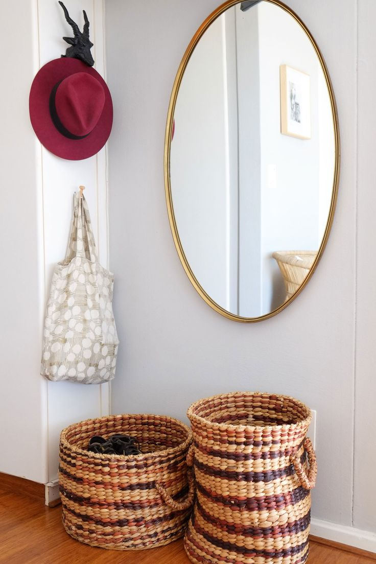 The oval mirror was inherited and the woven storage baskets are from @home.