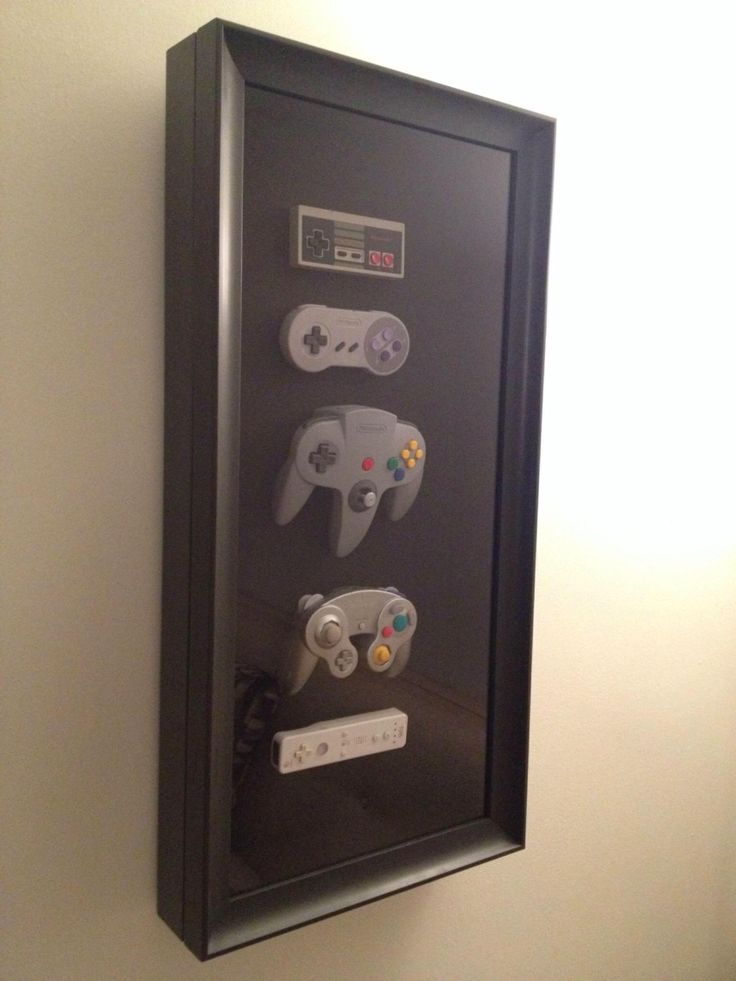 History of Nintendo controllers shadow box