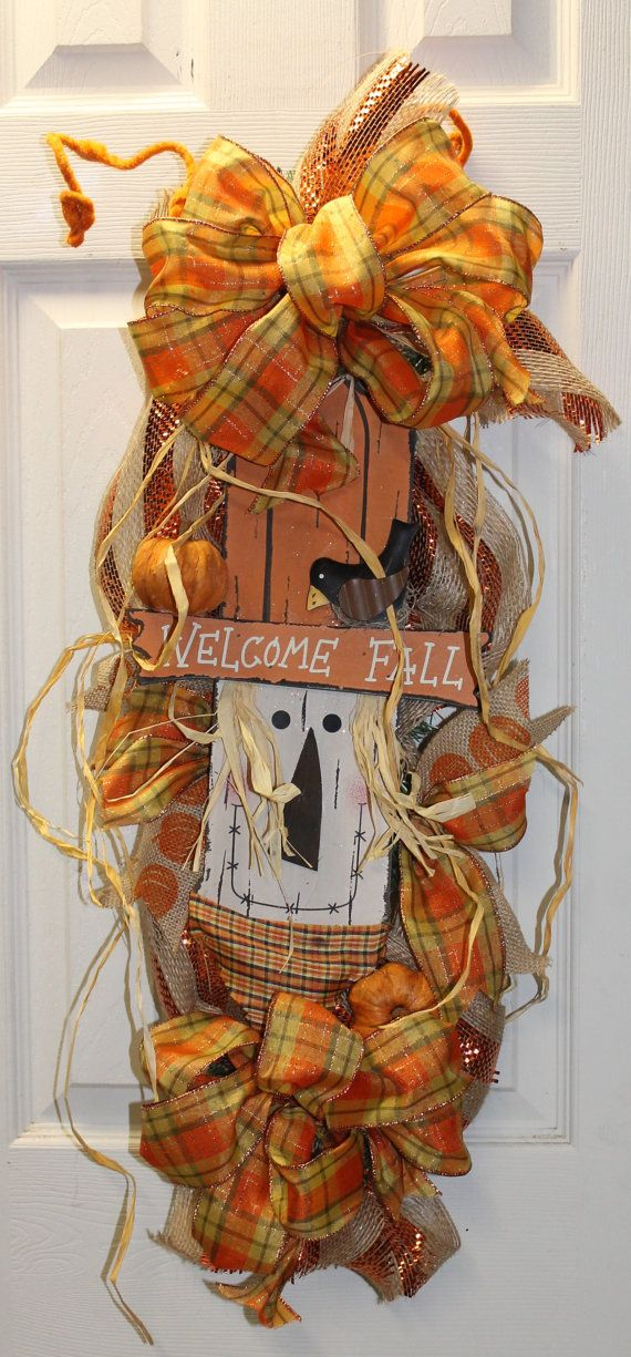 Welcome Fall! This guy is ready for cooler weather. This Fall swag is made with striped burlap mesh, pumpkin burlap, a little raffia, a couple
