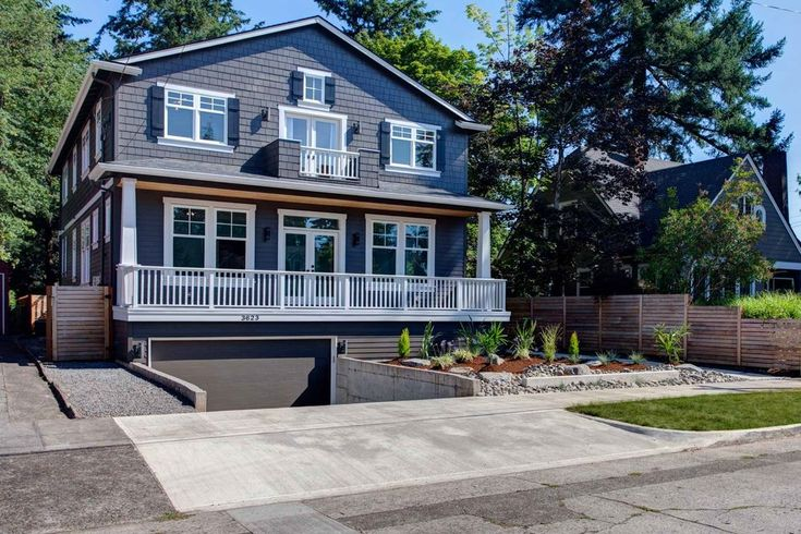 Shaver On The Park is a traditional style home in Portland,  Oregon, featuring fiber cement exterior, side entry porch, large front  windows, and private front porch.