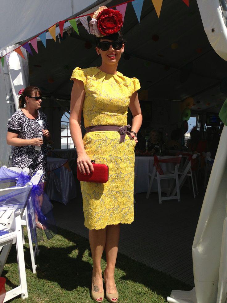 Racewear. Yellow lace skirt & top. Floral headpiece fascinator.