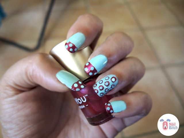 For the 11th day, I did polka dots two ways: First I did a free hand french tip with polka dots. For the accent, I did double polka dots, using different sizes doting tools