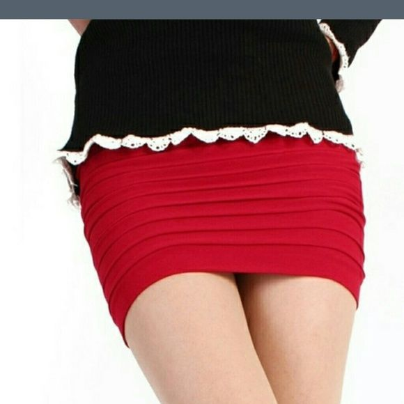 New in package Red pencil mini skirt Ruffle style bands all the way around the skirt. Very flattering. Fits tight but it's super soft and comfy. Great over leggings or tights or alone. Closet staple Skirts Mini