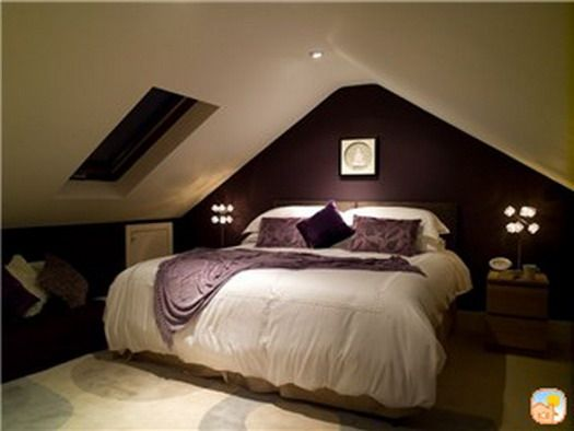 purple accent wall attic bedroom