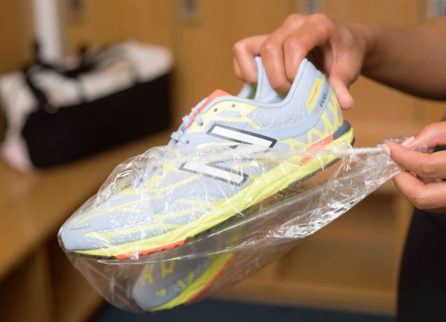 Wrap the soles of your shoes with a plastic shower cap before packing them.