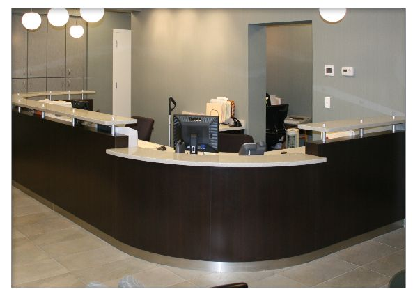 dental office reception designs | design makes this reception desk a striking complement to the office ...