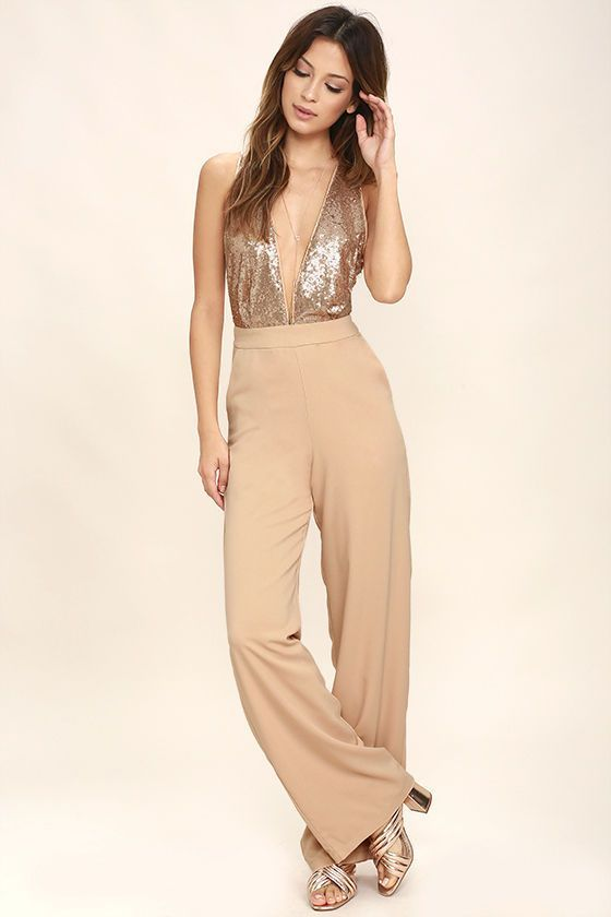 All eyes will be on you when you enter the dance floor in the Disco Heaven Beige Sequin Jumpsuit! A plunging, knit bodice (with crisscrossing back straps) is covered in glittering sequins. Tying waist sash and side seam pockets top the wide, woven pant legs. Hidden back zipper/clasp.