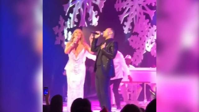Mariah Carey decks the halls with Christmas cleavage, spreads cheer with John Legend.