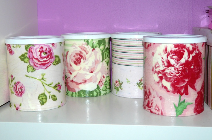 A set of baby formula cans that I decorated with napkins by using decoupage technique