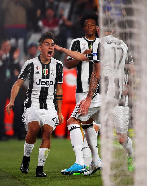 Paulo Dybala of Juventus celebrates after scoring his first goal during the UEFA Champions League Quarter Final first leg match between Juventus and FC Barcelona at Juventus Stadium on April 11, 2017 in Turin, Italy.