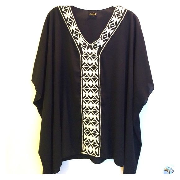 Black and white top Black and white short sleeve, polyester material, size small Audrey Brooke Tops Blouses