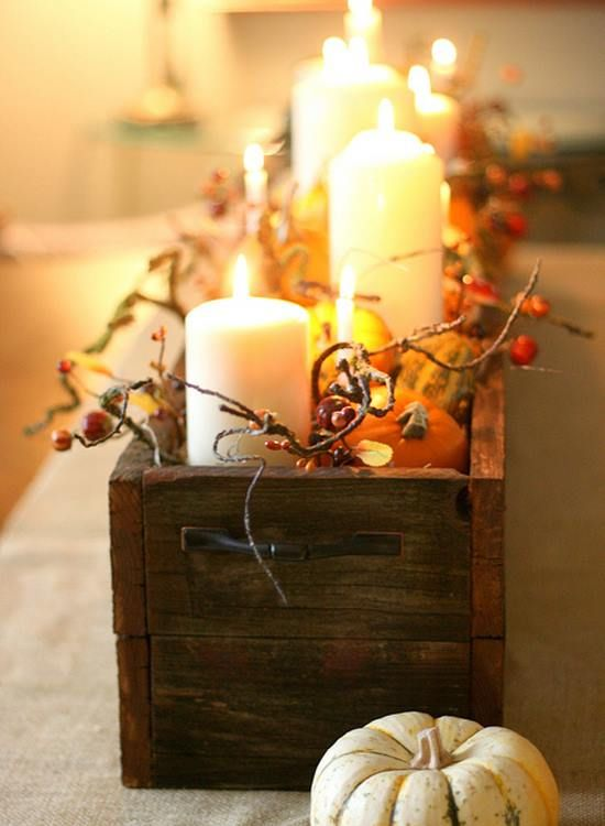 Wooden box with gold candles would look great on the table. You can substitute the box with white, silver or orange colors.