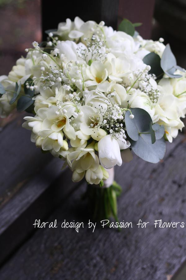 The bridal bouquet will include shades of ivory roses, mini callas, freesia, eucalyptus seeds, and amaranthus.
