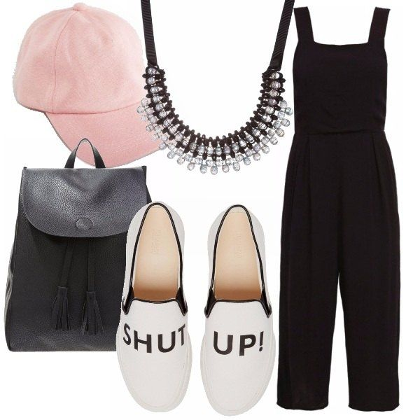 Jumpsuit nera, slip on slogan, zainetto similpelle, berretto rosa e collana a bavaglino. Una proposta per un concerto dallo stile rilassato e sporty, ma chic.