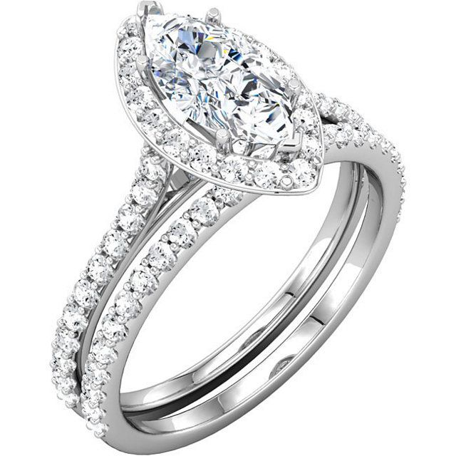 Want to update a wedding set with a marquise center diamond? This simple diamond halo and band are a great option!