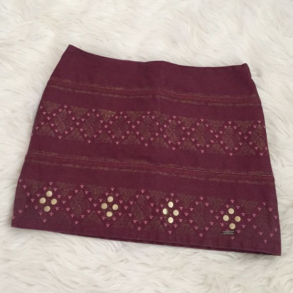 Aztec Print Tight Fitting Skirt Gorgeous tight Hollister skirt that has an Aztec like print. Is a maroon colors with pink and gold stud accents. I would keep this skirt if it still fit me. :( Was only able to wear it once. No signs of wear or tear! I bundle just ask or use the bundle feature!  Hollister Skirts