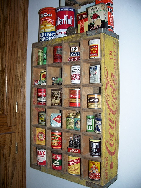 collection of tins in coca-cola crate - Or great for storage of kitchen goods, if lacking in storage space. Just AWESOME IDEA!!!!