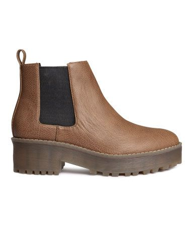 Chelsea-style boots in grained imitation leather with elastic panels at sides and chunky, rubber platform soles. Front platform height 1 1/4 in., heel height 2 in.