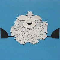 A Crafty Arab: 99 Creative Sheep Projects - Puzzle Piece Lamb - What could be more fun than this Recycled Puzzle Piece Lamb created by the FreeKidsCrafts Team?