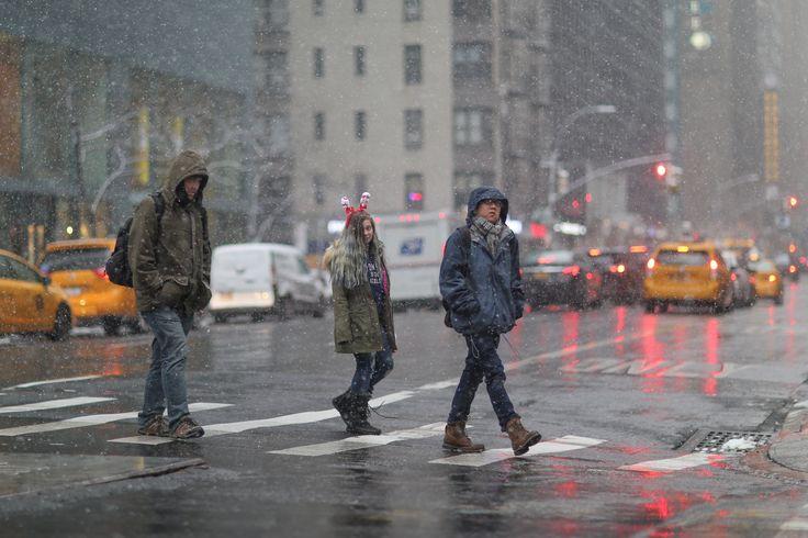 Crossing Lexington  Three people crossing Lexington Avenue in Midtown on the first snowfall of the season.  Also, SantaCon.  #nyc #newyorkcity #manhattan #streetphotography #winter #snow