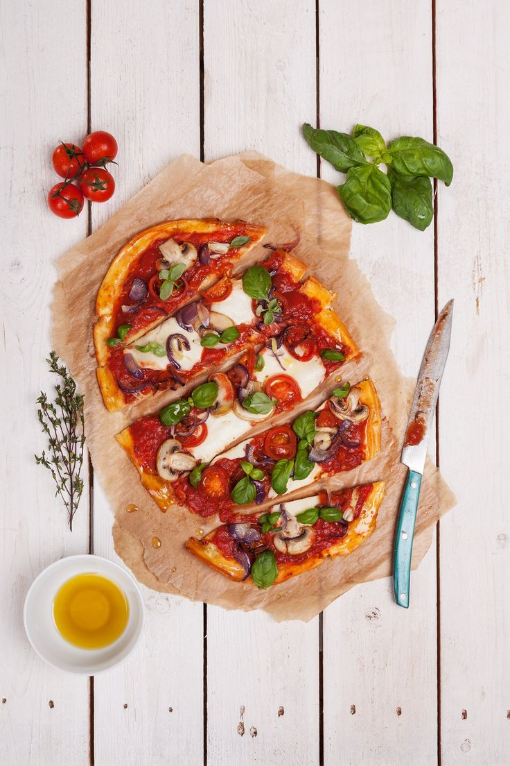 Gluten-free pizza dough•150 g gluten free flour Nomix•1.5 g sugar•6 g yeast•90 ml water• 1-2 g salt• 1 egg.Of all the raw materials create a smooth dough and let it rest for 10 minutes. After this time, roll the dough into a thin layer and put on a plate in advance spilled (from gluten-free flour). We can put on dough cheese with vegetables or chicken, as always we must create tomato sauce from tomato puree and herbs. Bake at about 230 °C for 6 minutes.