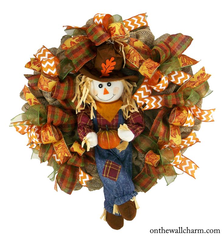 This is a lovely Fall Deco Mesh Wreath with a darling Scarecrow boy holding his pumpkin. Fall colored ribbon was added to coordinate with the little boy. It is perfect for your front door to great you