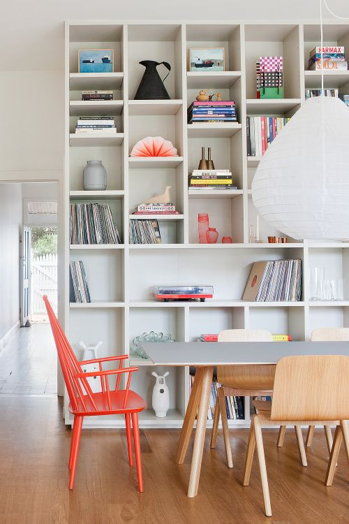 white builtin bookshelves with colorful decor by made by cohen sfgirlbybay