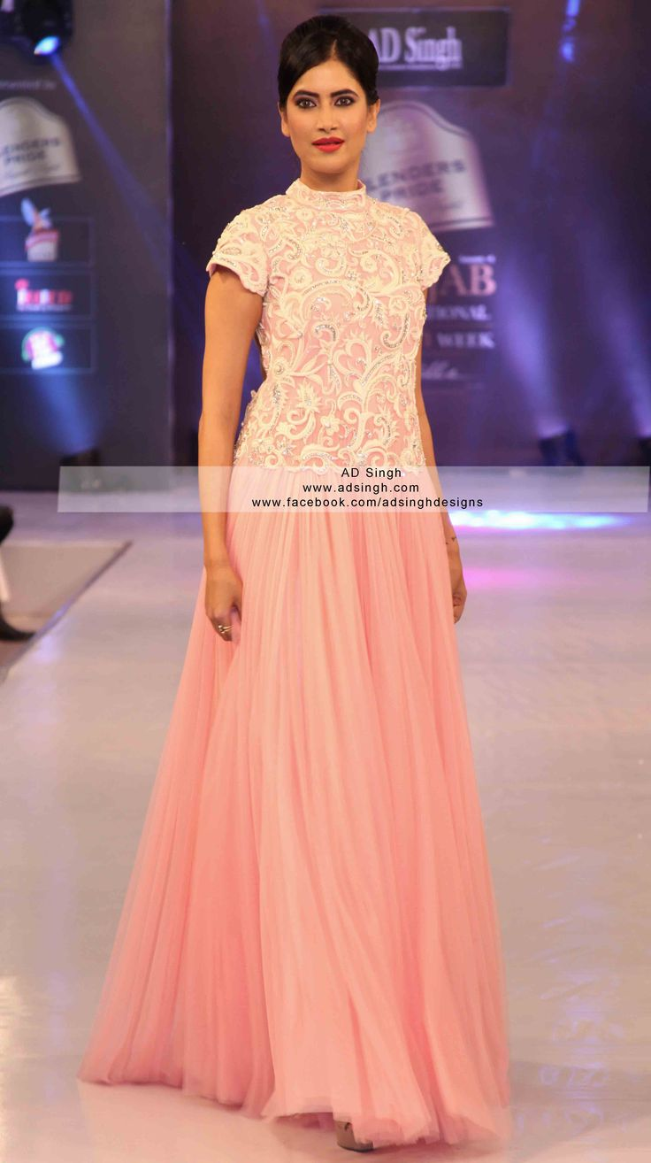Baby Pink collar red carpet couture gown from AD SINGH. Made in intricate resham this Indian wedding gown has asexy scoop back for more info email info@adsingh.com