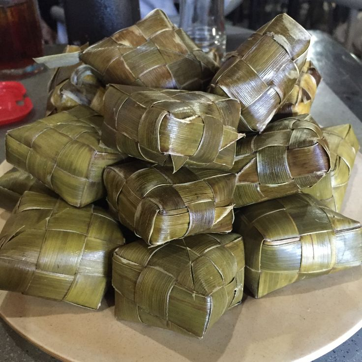 Buras or Burasa is a type of rice dumpling cooked with coconut milk packed inside a banana leaf pouch. It is a delicacy of the Bugis and Makassar people of South Sulawesi, Indonesia, and often consumed as a staple to replace steamed rice or ketupat. It is similar to lontong, but with richer flavour acquired from coconut milk.  Buras is made by steaming the rice until half-cooked, then cooking further in coconut milk mixed with daun salam (Indonesian bay leaf) and salt until all of the…