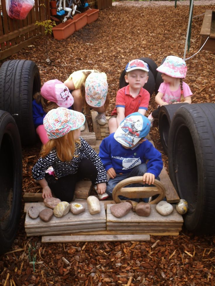 making a car, loose parts, tyres, stones and wood