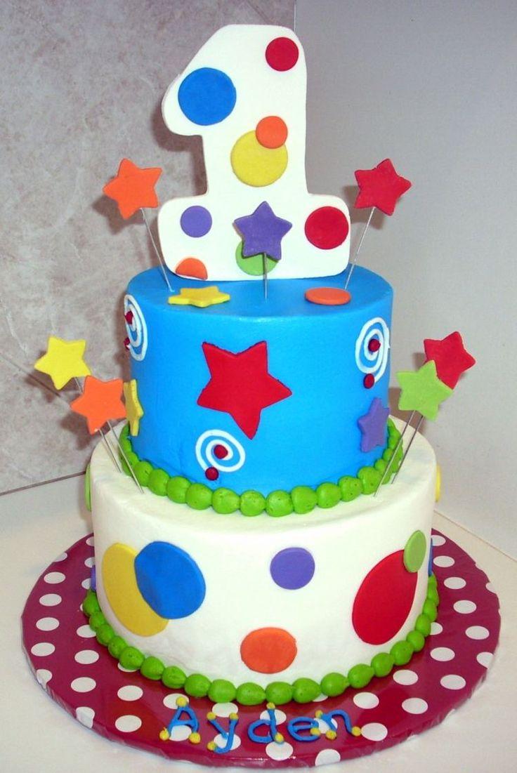 gâteau bébé en bleu et blanc décoré d'étoiles et pois multicolores