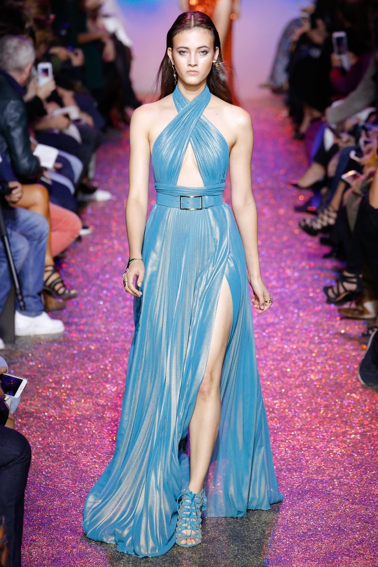 Elie Saab Spring 2017 RTW: Beautiful Blue! This blue halter gown with triangle cutout and thigh high slit is gorgeous! I love the pleat detail and the draping is exquisite!