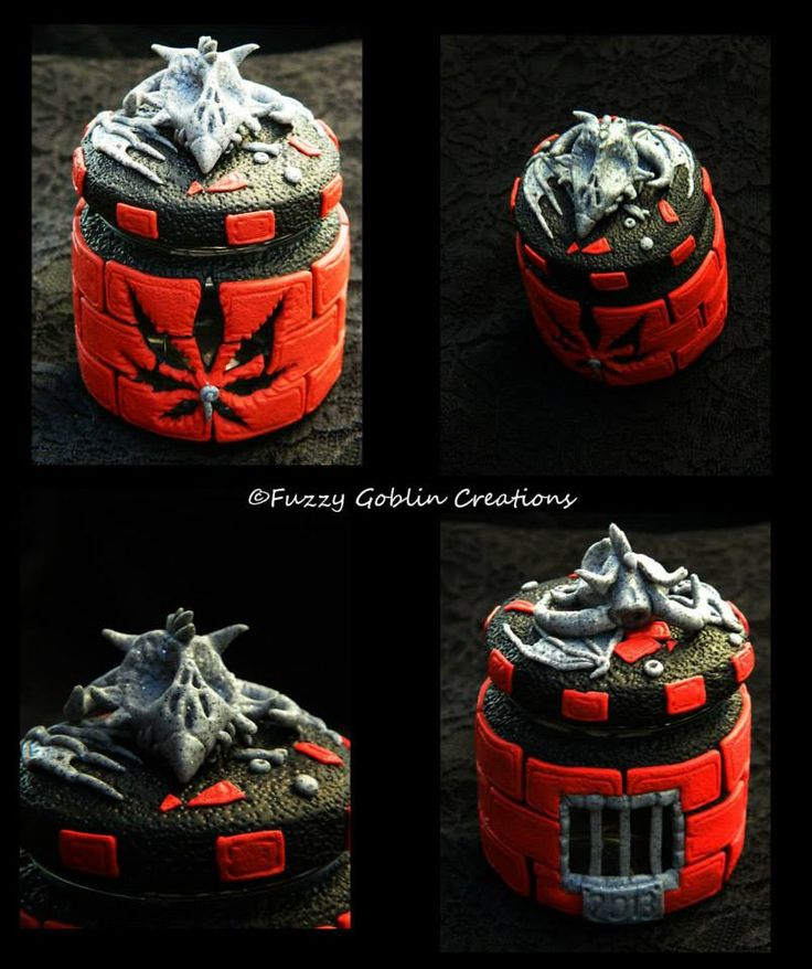 glass jar wrapped in polymer clay and prison/dragon themed