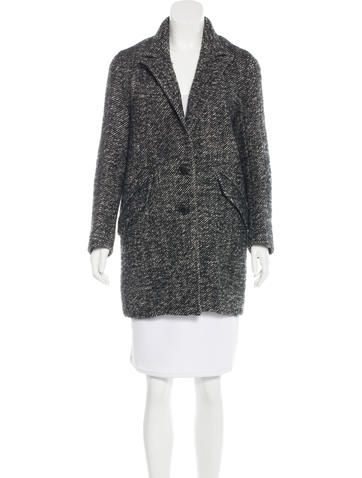 Black and white Étoile Isabel Marant wool short coat with notch lapel, dual flap pockets at hips and button closures at front. Designer size 3.