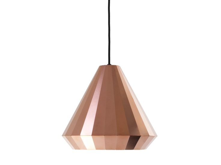 Copper Light 25: Simply by folding, a thin copper sheet can be used to construct stable forms. This principle defines the shape and aesthetics of the Copper Lights. For precise bending, the lines have been etched halfway into the material.  By reflecting its surroundings, each facet gets a different tone, from dark brown to red to orange. The material gives a warm colour to the light that shines from these delicate lamps.