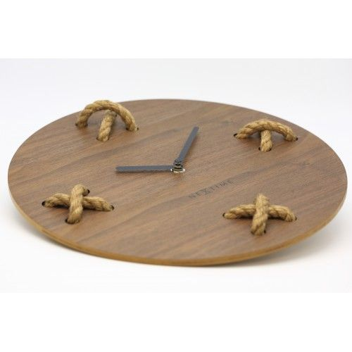 Stitch (3111BR), designed by Jette Scheib. Is a modern, fun clock made out of wood that will put a smile on your face. You can hang the clock by its rope onto the wall. This sturdy clock will enrich anyone's home. http://nextime.eu/en/root/stitch-33-cm.html
