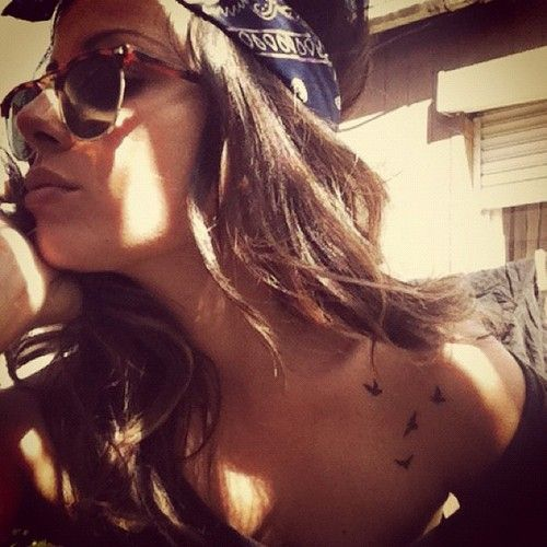 little birds tatoo on the front of the shoulder.