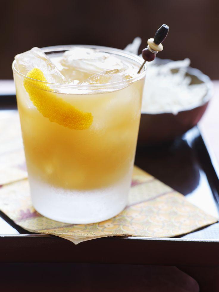 PF Chang's Twisted Whiskey Sour ~ 1.25 ounces Woodford Reserve Bourbon, .75 ounces Cointreau, .25 ounces honey water, 1.5 ounces orange juice, .75 ounces lemon juice, dash bitters, dash blood orange bitters.