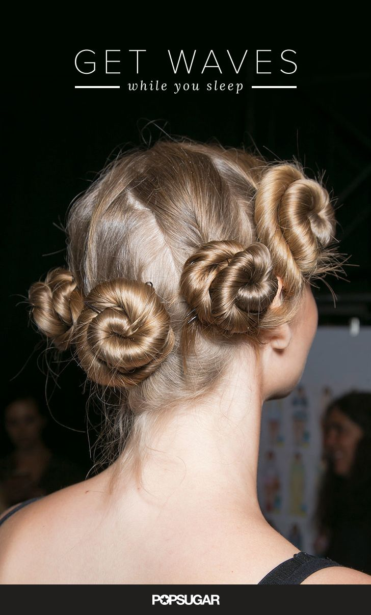 "Dampen your mane with a blend of hold and shine products like TRESemmé Make Waves. Twist locks into one long spiral, then ""cinnamon bun"" the hair up into a knot, making sure to tuck the ends under. Hold the style in place with a rubber band. When the knots are completely dry, unravel for no-heat waves."