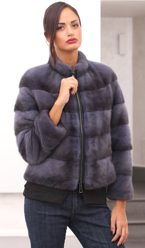Female Mink Fur with whole skins. Made in Italy. Skins Quality: KOPENHAGEN FUR PLATINUM; Color: Blue Denim; Closure: With zip; Collar: Round; Lining: 100% Satin; Lining Color: Fantasy, Multicolor; Length: 55 cm; #elsafur #fur #furs #furcoat #coat #mink #minkcoat #cappotto #peliccia #pellicce